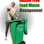 lady adding food to green bin