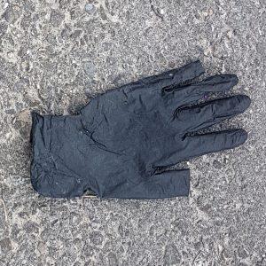 gloves litter disposed on street
