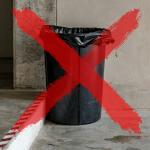 small useless garage trash can